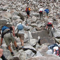 12. On the cove side of the lake is a boulder field. Hikers who decide to loop around the lake will need to cross it.