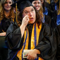 A Salt Lake Community College graduate wipes away a tear while listening to SLCC President Deneece Huftalin speak during the 2017 commencement ceremony at the  Maverik Center in West Valley City on Friday, May 5, 2017.