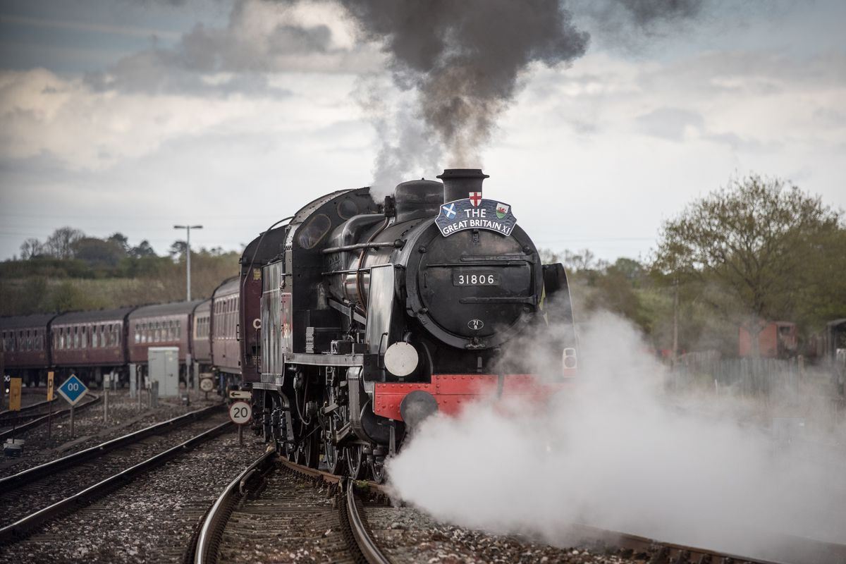 Mogul Steam Train Pulls Passenger Carriages From Cardiff To Weymouth