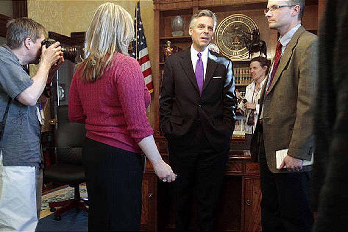 Gov. Jon Huntsman Jr. talks to the media Thursday about accomplishments in the 2009 session, hailing new initiatives on renewable energy and liquor-reform legislation.