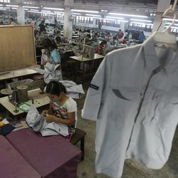 In this photo taken Saturday, April 21, 2012, a young worker sews a shirt at a garment factory in Yangon, Myanmar. On Monday, April 23, 2012, the European Union confirmed it was suspending most of its sanctions against Myanmar to reward the country's recent wave of political reform. The suspension of trade sanction could help revive the nation's industries, restoring some of the 80,000 garment industry jobs lost here over the past 10 years.