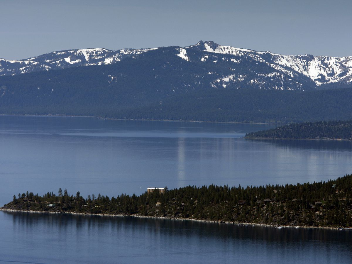 A view of snow-capped mountains, Lake Tahoe, and the historic Cal Neva Resort, Spa and Casino