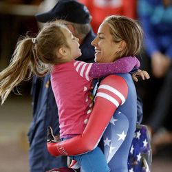 Noelle Pikus-Pace receives a hug from her daughter Lacee, 5, after competing in the United States women's skeleton team trials Monday, Oct. 28, 2013, in Park City, Utah. Noelle Pikus-Pace came in first place after 2 heats.