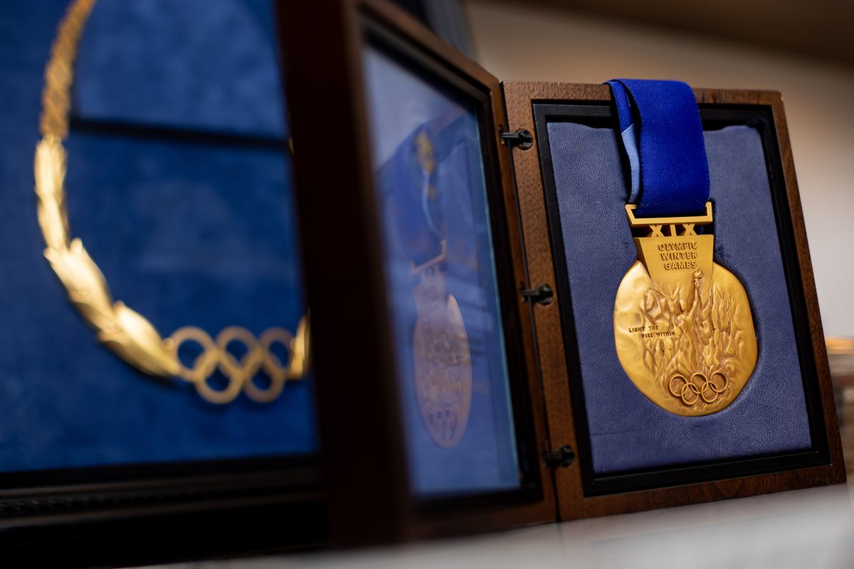 A gold medal from the 2002 Winter Olympics, right, and the Olympic Order in Gold, which was awarded to Fraser Bullock, who served as chief operating officer for the Salt Lake Organizing Committee for the games, are pictured in Bullock's home in Alpine on Tuesday, Aug. 31, 2021.