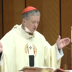 Cardinal Blase Cupich celebrates the Holy Thursday Mass removing it while speaking during the liturgy at Holy Name Cathedral.