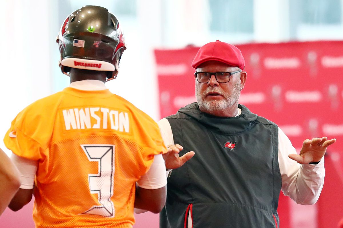 Tampa Bay Buccaneers head coach Bruce Arians talks with quarterback Jameis Winston at AdventHealth Training Center.