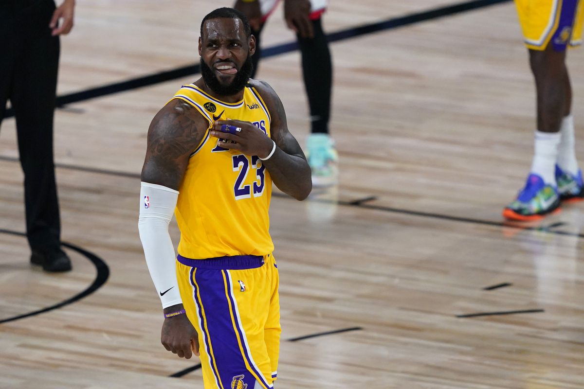 LeBron James of the Los Angeles Lakers celebrates a play during the second half of an NBA basketball game against the Toronto Raptors at The Arena in the ESPN Wide World Of Sports Complex on August 1, 2020 in Lake Buena Vista, Florida.