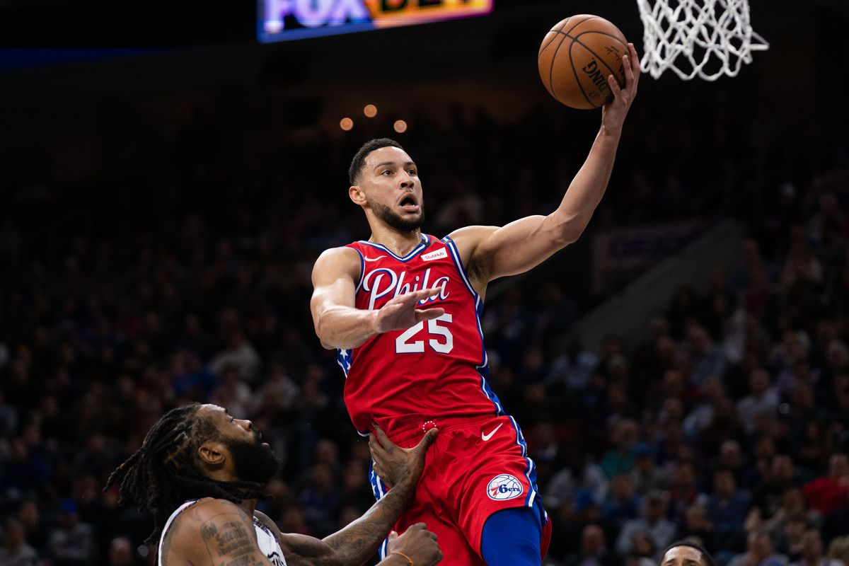 Philadelphia 76ers guard Ben Simmons drives against Brooklyn Nets center DeAndre Jordan during the first quarter at Wells Fargo Center.