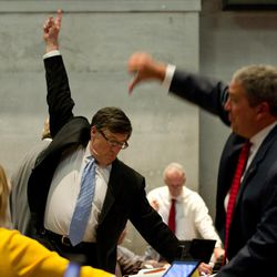 House Minority Leader Craig Fitzhugh of Ripley, left, signals for his Democratic colleagues to vote for an amendment during a floor debate over the state's annual spending plan in the House chamber in Nashville, Tenn., on Thursday, April 26, 2012. At right is House Majority Leader Gerald McCormick, R-Chattanooga, signaling to vote no. The chamber later approved its version of the spending plan.