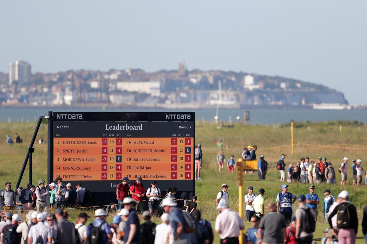 Spectators by the scoreboard on the course during day three of The Open at The Royal St George's Golf Club in Sandwich, Kent.