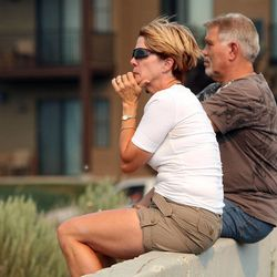 Pam and Doug Jepperson watch a wild fire grow before being evacuated from their home near the Jordanelle Reservoir on Saturday, Aug. 18, 2012.