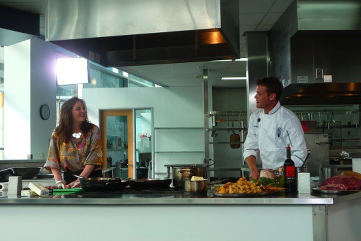 Julie Powell (Julie & Julia) assists Chef Brian Malarkey with a cooking demo at Le Cordon Bleu in Hollywood.