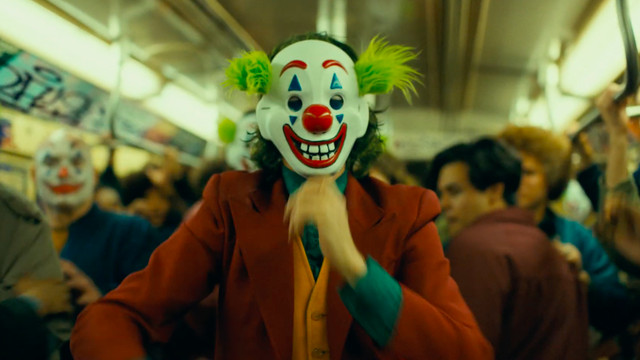 the joker wearing a clown mask in the new york subway in the joker
