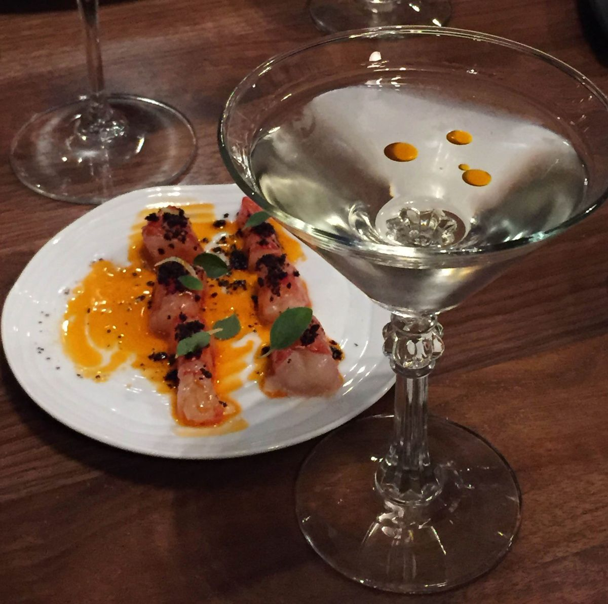 Specially garnished martini paired with shrimp crudo. Photo by Andy Lien