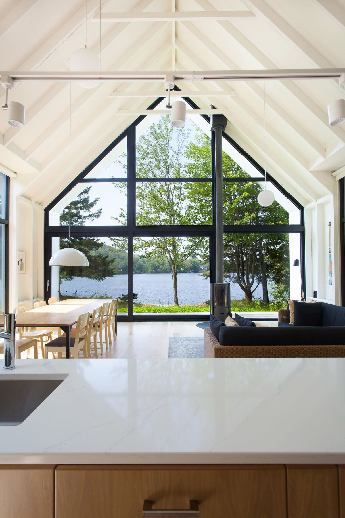 Living room with windows looking onto lake
