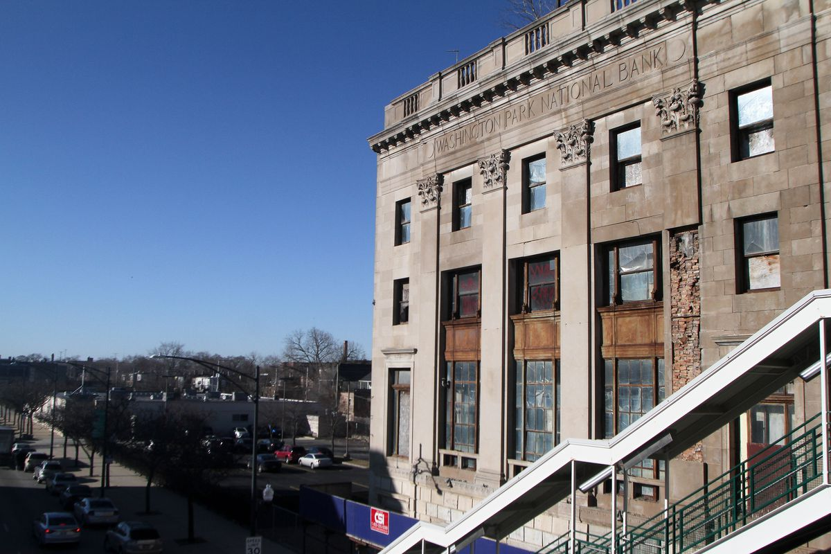 The old Washington Park National Bank building, 6300 S. Cottage Grove Ave., with stairs to the CTA's Green Line in the foreground.