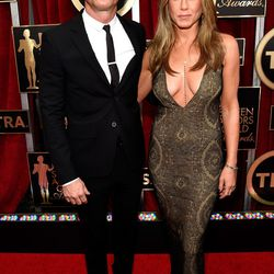 Justin Theroux and Jennifer Aniston in vintage Galliano.