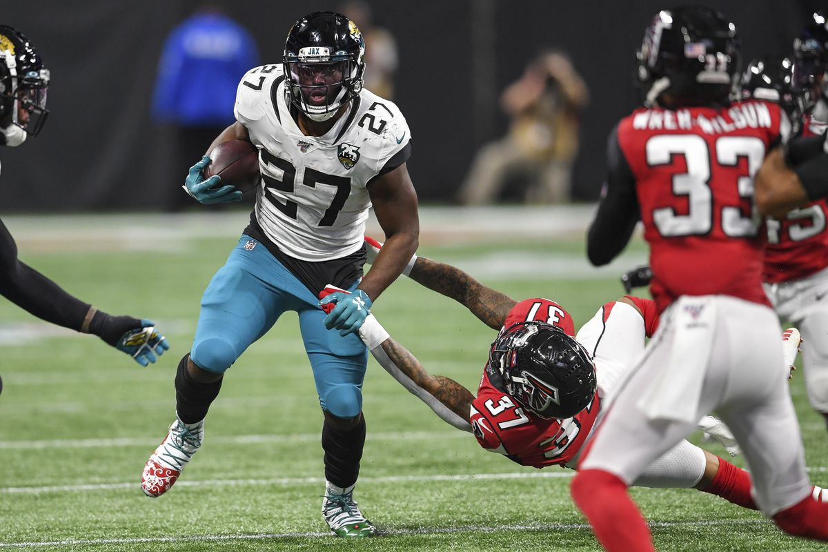 Jacksonville Jaguars running back Leonard Fournette breaks a tackle by Atlanta Falcons safety Ricardo Allen during the second half at Mercedes-Benz Stadium.