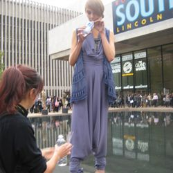 A Malandrino model is brought water - presumably so she doesn't get weak and fall off her pedestal