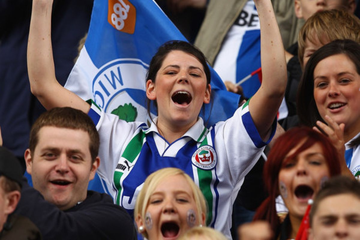 Wigan Athletic fans show their support during the Barclays Premier League match between Stoke City and Wigan Athletic at Britannia Stadium.