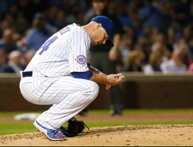 Lester takes a moment after being hit on the wrist Tuesday.