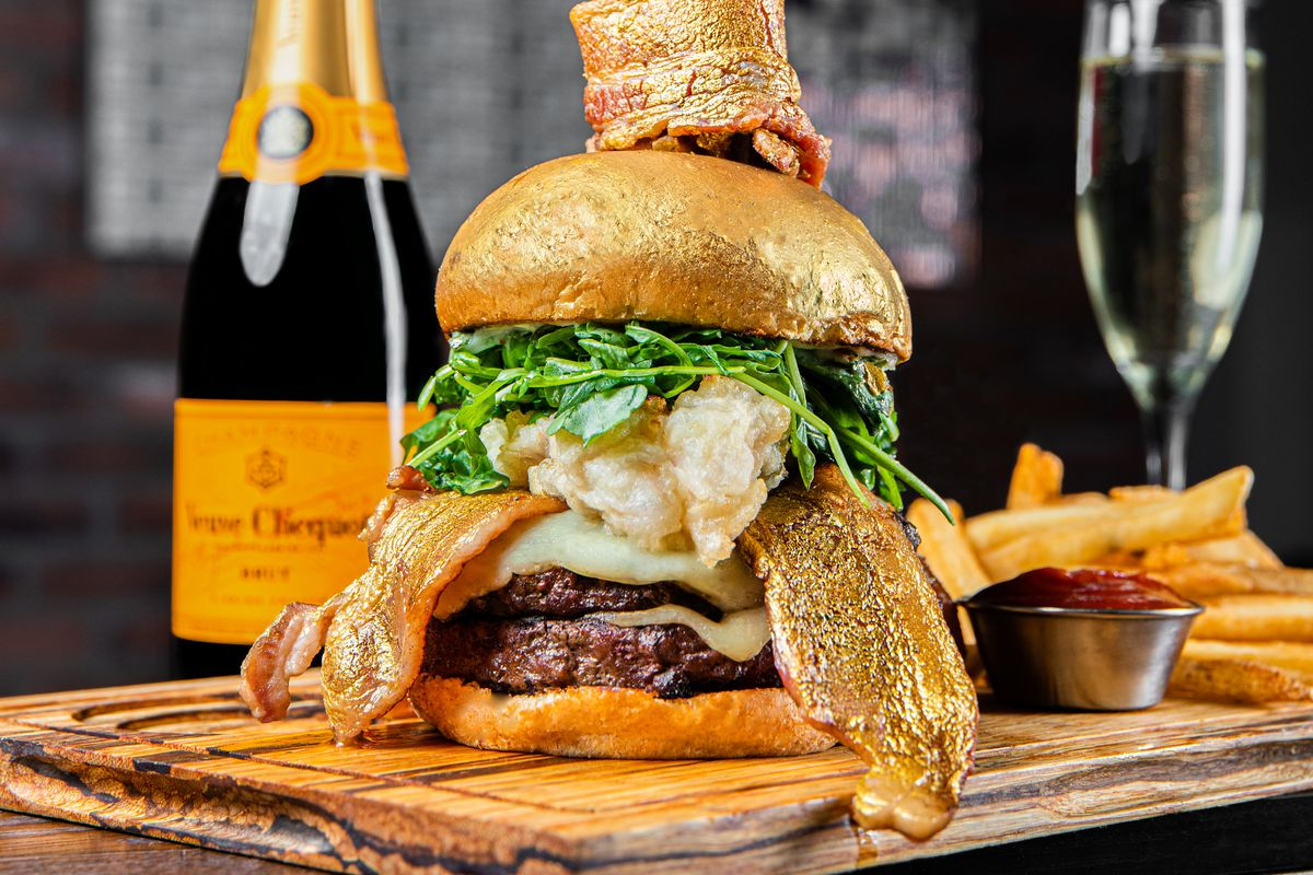 A burger with fried lobster tale, one pound of wagyu beef, and more