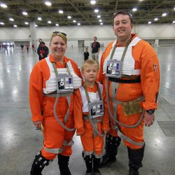 Beth, Logan and Trent Hawkes, of Layton, dressed as X-Wing pilots from Star Wars, pose for a picture at Salt Lake Comic Con FanXperience.