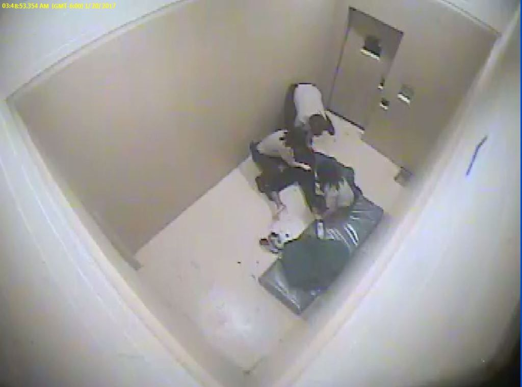 Zandrea Askew was thrown onto a bench and then to the ground before she was strip searched by LaSalle County Sheriff's deputies in January 2017, a lawsuit alleges.   Provided/Screenshot o surveillance video screenshot