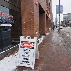 Warning signs up, around the office building at Gallagher Way