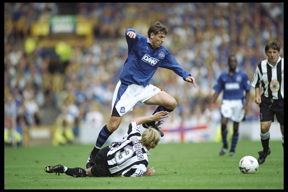 Andrei Kanchelskis of Everton skips over a challenge from John Beresford of Newcastle