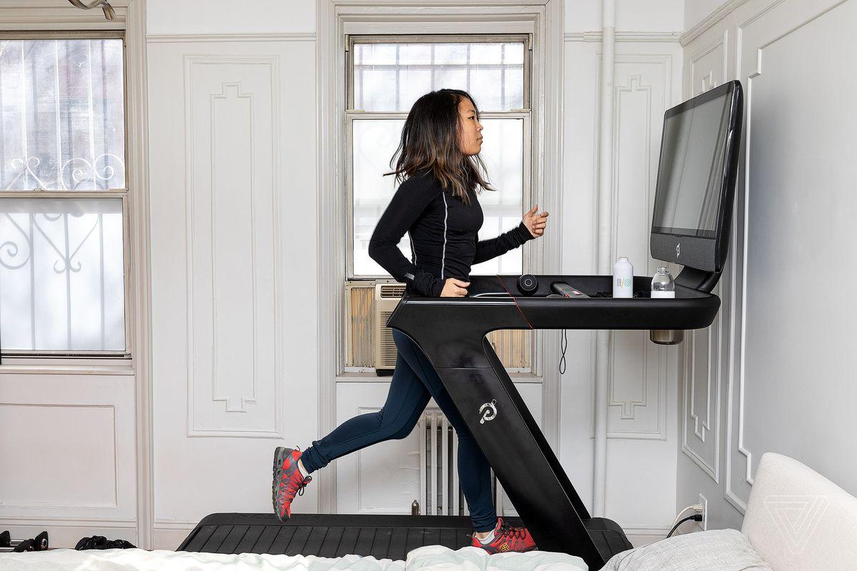 A runner trains on the Peloton Tread.