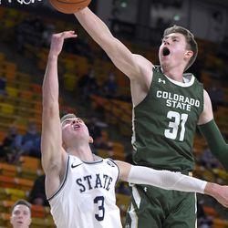 Colorado State forward Adam Thistlewood (31) blocks the shot of Utah State guard Steven Ashworth (3) during the second half of an NCAA college basketball game Thursday, Jan. 21, 2021, in Logan, Utah.