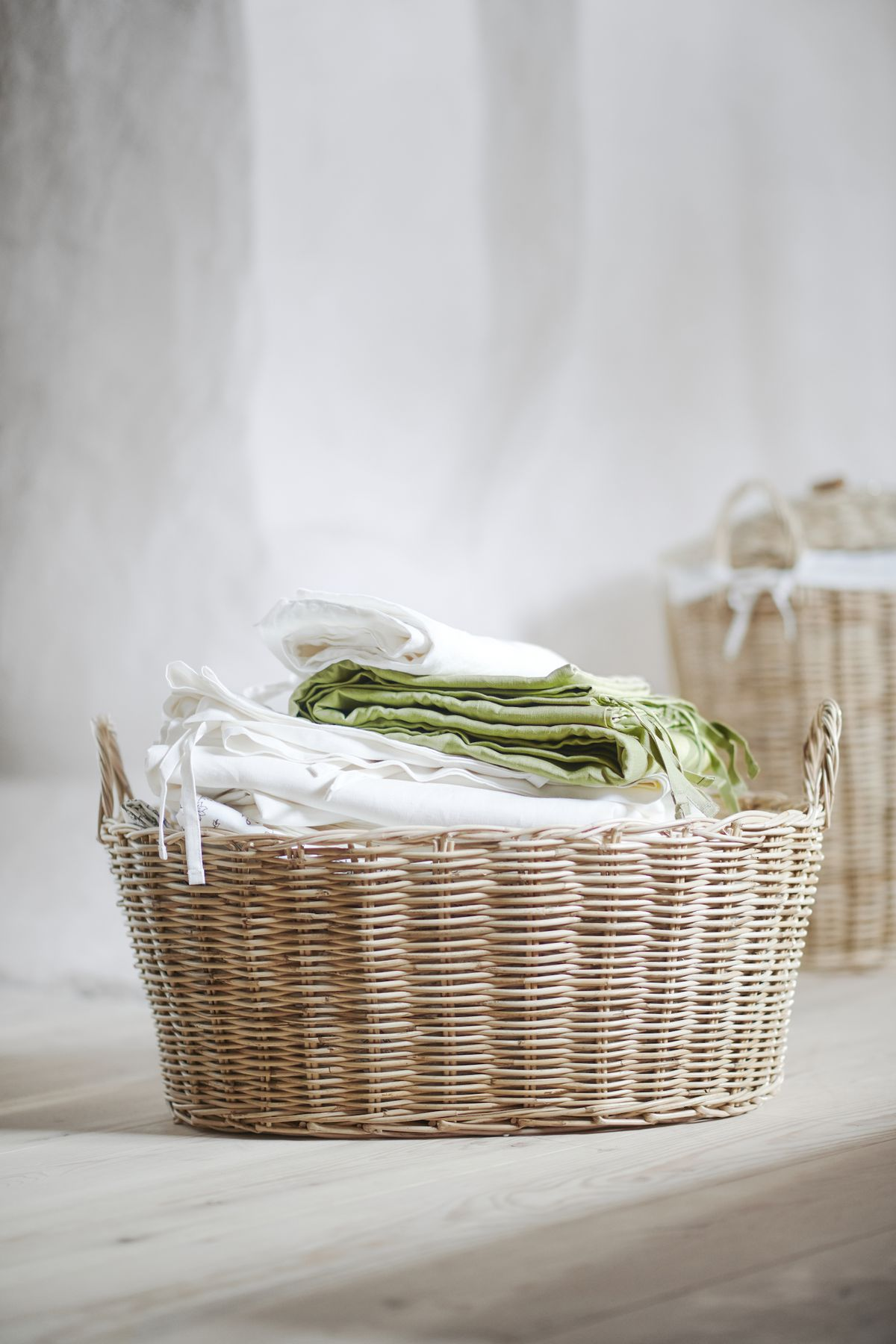 Rattan basket filled with textiles.