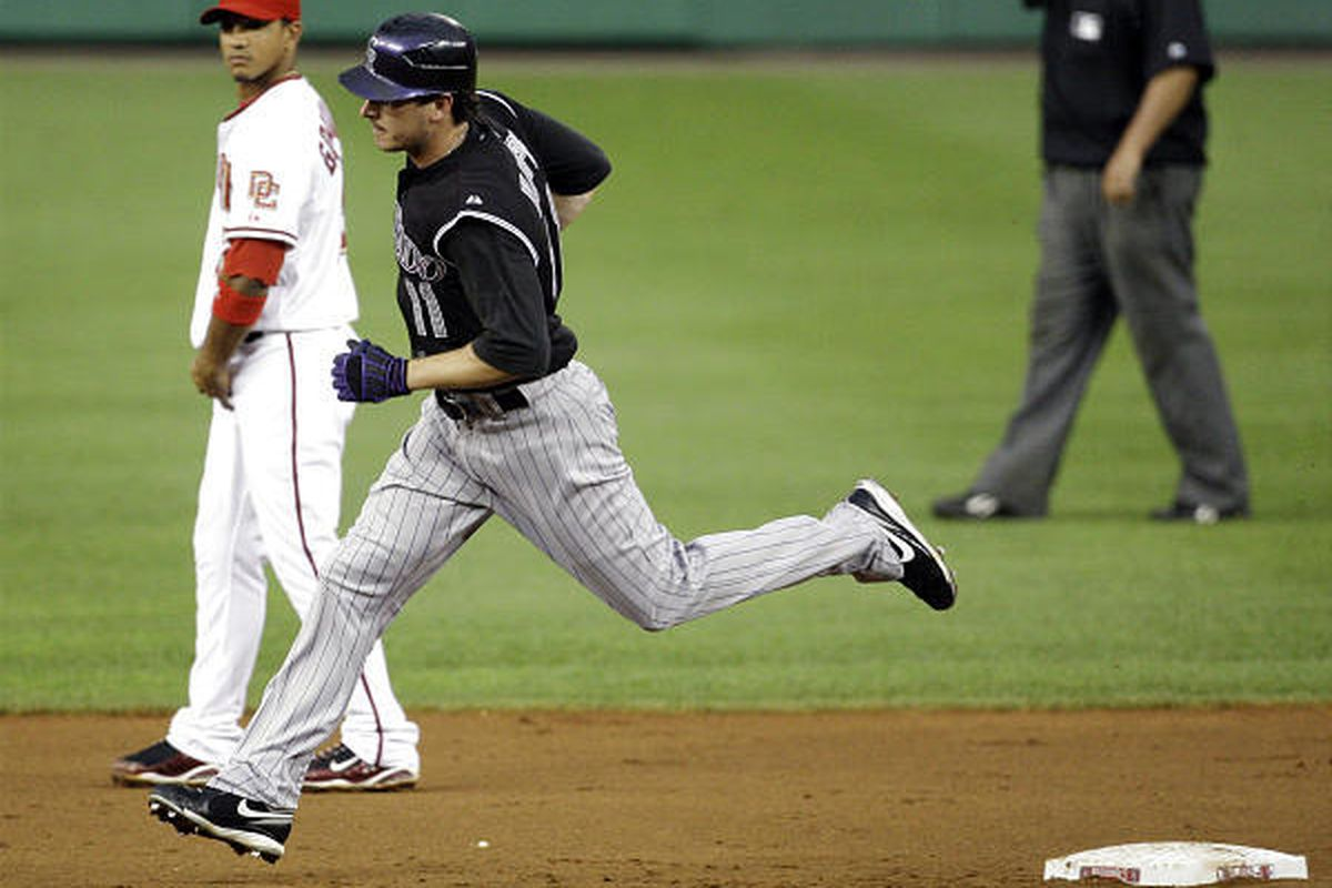 Colorado Rockies' Brad Hawpe rounds second base after hitting a solo home run to center field.