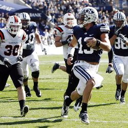 Brigham Young Cougars quarterback Riley Nelson runs to the corner of the endzone for a touchdown as Brigham Young University faces Idaho State in NCAA football in Provo, Saturday, Oct. 22, 2011.