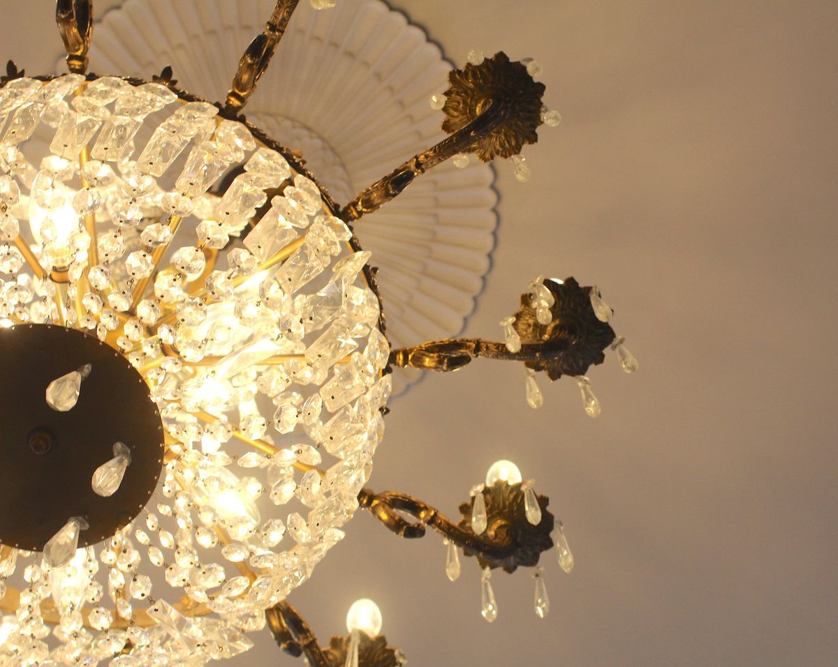 An ornate brass and crystal chandelier
