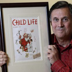 """Don Trachte of Bennington, Vt., poses with a1953 Child Life magazine cover illustration """"Santa's Helpers"""" by Norman Rockwell for which he modeled, at the Bennington Museum on Friday, Sept. 28, 2012, in Bennington, Vt. Trachte is the child on the left."""