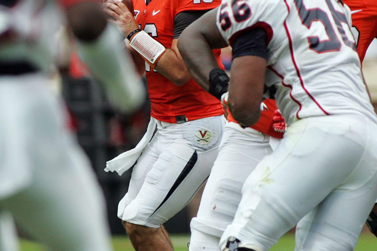 Sept 1, 2012; Charlottesville, VA, USA;  Virginia Cavaliers quarterback Michael Rocco (16) drops back to pass against the Richmond Spiders at Scott Stadium. Mandatory Credit: Peter Casey-US PRESSWIRE