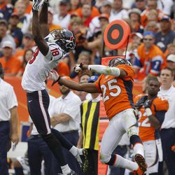 Houston Texans wide receiver Lestar Jean (18) leaps to catch a pass against Denver Broncos strong safety Chris Harris (25) in the third quarter of an NFL football game Sunday, Sept. 23, 2012, in Denver.