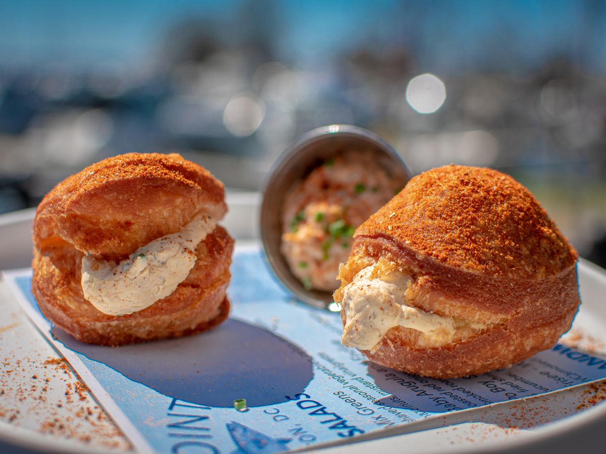 The point's savory doughnuts are stuffed with crab dip and coated in Old Bay