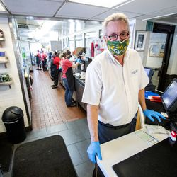 Longtime Hires Big H employee Jim Merrill poses for a photo as he works his last week of shifts at the burger joint in Salt Lake City on Friday, Jan. 8, 2021. Merrill has worked at the company for 52 years.