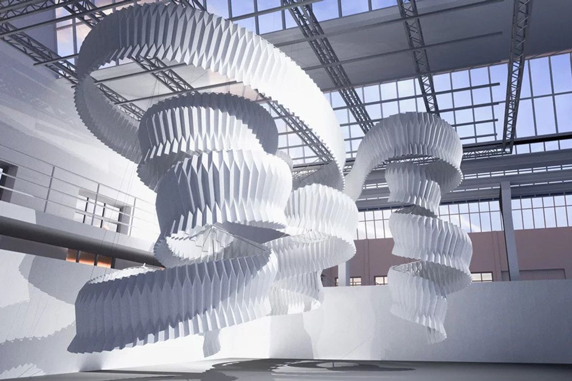 White origami sculpture hanging from ceiling