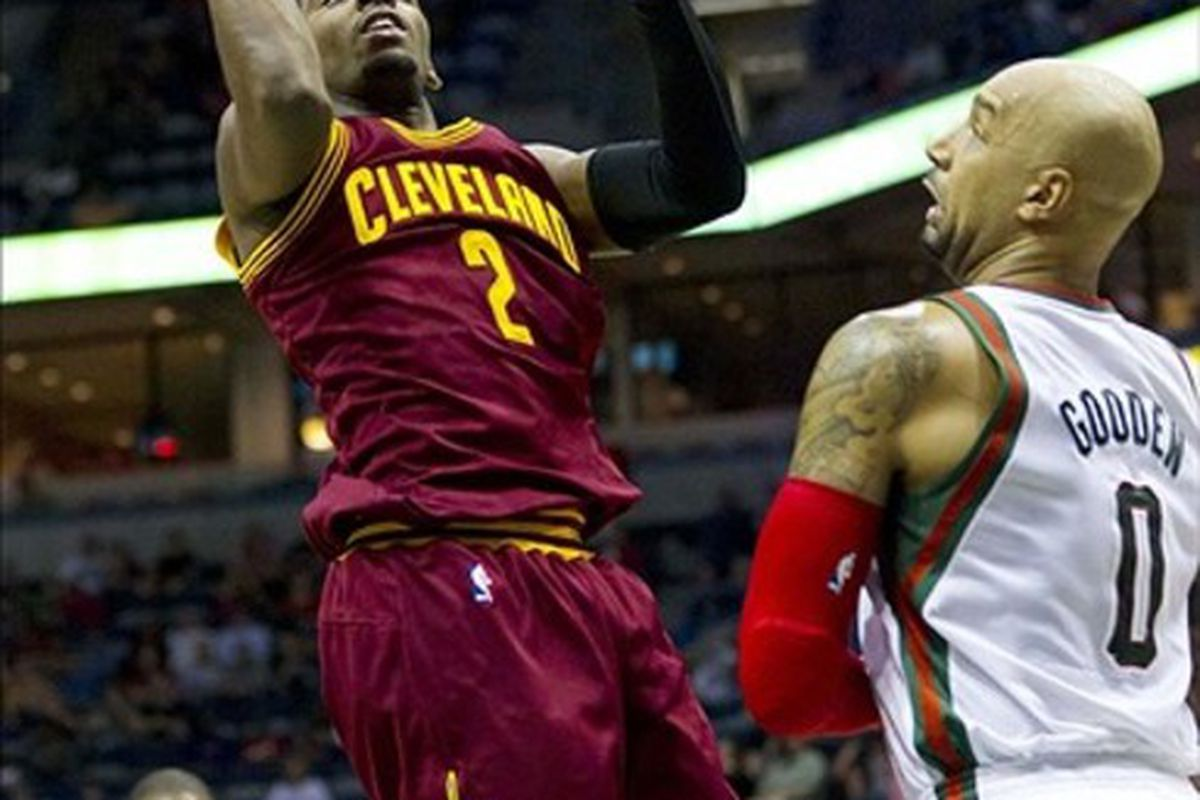 Mar 14, 2012; Milwaukee, WI, USA;  Cleveland Cavaliers guard Kyrie Irving (2) shoots over Milwaukee Bucks forward Drew Gooden (0) during the first quarter at the Bradley Center.  Mandatory Credit: Jeff Hanisch-US PRESSWIRE