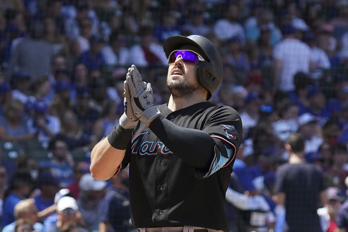 Adam Duvall #14 of the Miami Marlins hits a two-run home run against the Chicago Cubs during the third inning of a game at Wrigley Field