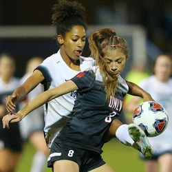 BYU Nadia Gomes (6) kicks the ball around UNLV defender Paige Almendariz (8) as BYU and UNLV play in the first round of the NCAA tournament in Provo on Friday, Nov. 11, 2016.