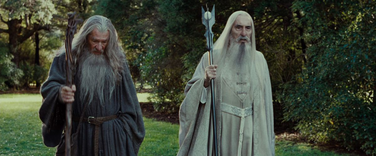Gandalf and Saruman walk the gardens of Orthanc in The Fellowship of the Ring.
