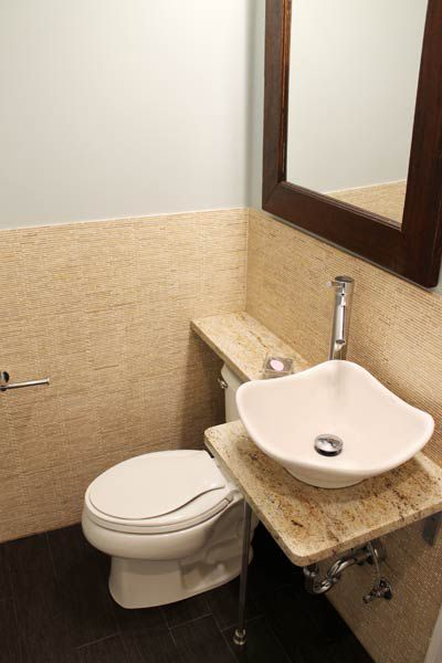 Toilet with a shelf built above the tank.