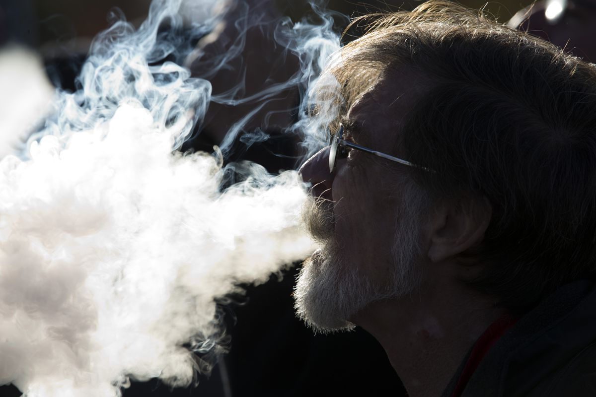 Close-up of demonstrator vaping during a rally outside of the White House to protest the proposed vaping flavor ban in Washington DC on November 9, 2019.