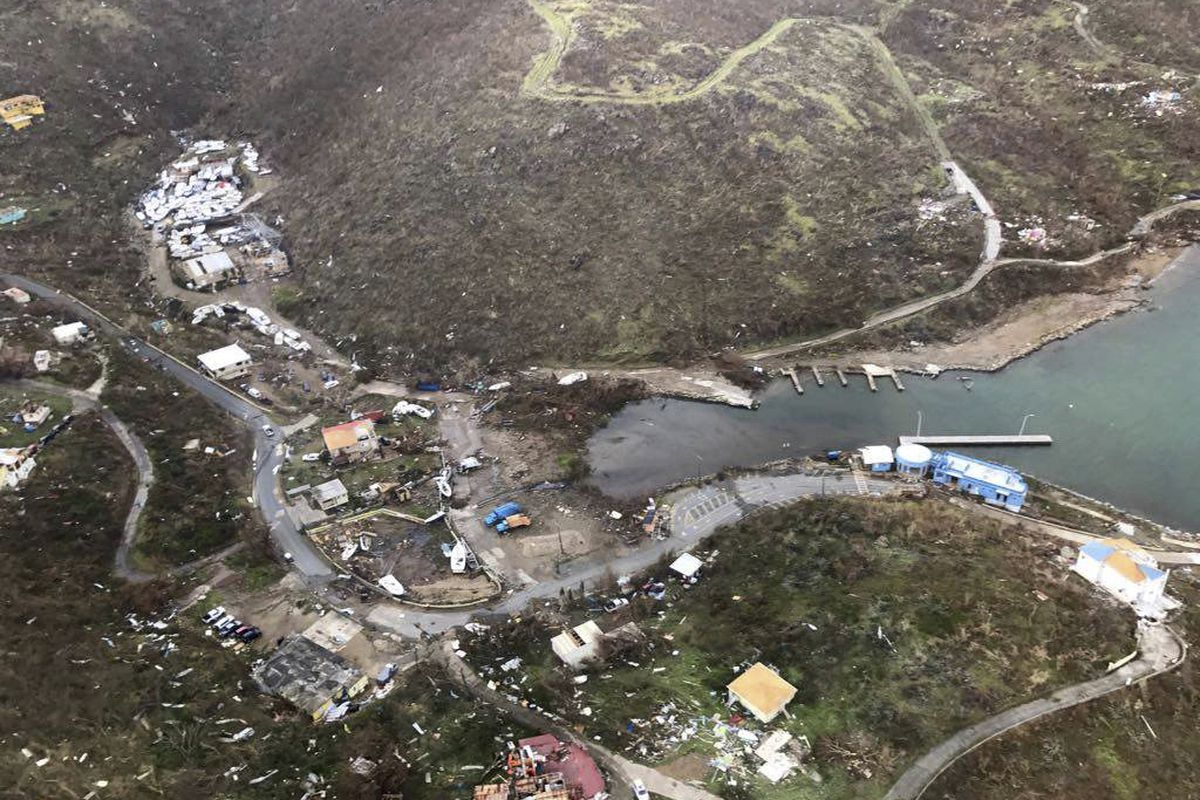 CORRECTS DAY - This photo provided on Friday, Sept. 8, 2017, shows storm damage in the aftermath of Hurricane Irma in Virgin Gorda's Gun Creek in the British Virgin Islands. Irma scraped Cuba's northern coast Friday on a course toward Florida, leaving in