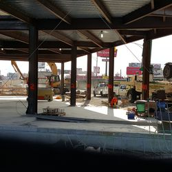 10:59 a.m. View of ground level of plaza building -